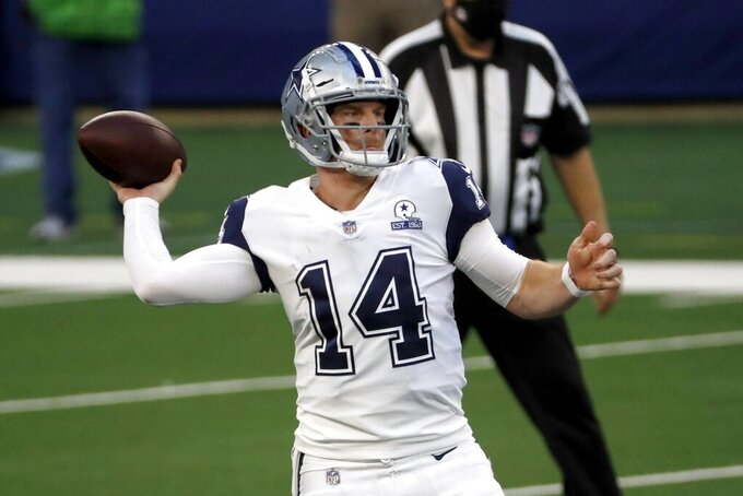 Dallas Cowboys quarterback Andy Dalton (14) throws a pass in the first half of an NFL football game against the Washington Football Team in Arlington, Texas, Thursday, Nov. 26, 2020. (AP Photo/Roger Steinman)