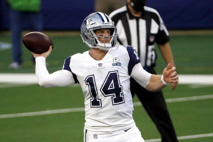 Dallas Cowboys quarterback Andy Dalton (14) throws a pass in the first half of an NFL football game against the Washington Football Team in Arlington, Texas, Thursday, Nov. 26, 2020. (AP Photo/Roger Steinman)