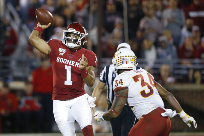 Oklahoma quarterback Jalen Hurts (1) throws under pressure from Iowa State linebacker O'Rien Vance (34) during the third quarter of an NCAA college football game in Norman, Okla., Saturday, Nov. 9, 2019. (AP Photo/Sue Ogrocki)