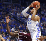 Texas A&M's Christian Mekowulu, bottom, draws a charging foul on Kentucky's PJ Washington (25) during the first half of an NCAA college basketball game in Lexington, Ky., Tuesday, Jan. 8, 2019. (AP Photo/James Crisp)