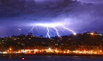 This time exposure photo provided by the Santa Barbara County Fire Department shows a series of lightning strikes over Santa Barbara, Calif., seen from Stearns Wharf in the city's harbor, Tuesday evening, March 5, 2019. A storm soaking California on Wednesday could trigger mudslides in wildfire burn areas where thousands of residents are under evacuation orders, authorities warned. The Santa Barbara County Sheriff's Office ordered 3,000 residents to evacuate hillside neighborhoods scarred by fires — including parts of Montecito hit by a disastrous debris flow just over a year ago. (Mike Eliason/Santa Barbara County Fire Department via AP)