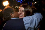 Candidate Regina Romero hugs U.S. Rep. Raul Grijalva at an election night party at Hotel Congress shortly before she was announced the winner and the city's next mayor, in Tucson, Ariz., Tuesday, Nov. 5, 2019. (Kelly Presnell/Arizona Daily Star via AP)