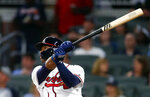 Atlanta Braves' Ronald Acuna Jr. follows though on a home run in the eighth inning of the team's baseball game against the Chicago Cubs on Tuesday, May 15, 2018, in Atlanta. Chicago won 3-2. (AP Photo/John Bazemore)