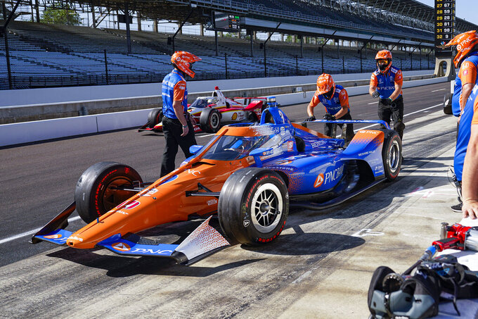 Scott Dixon, of New Zealand, pulls out of the pit area during practice for the Indianapolis 500 auto race at Indianapolis Motor Speedway in Indianapolis, Sunday, Aug. 16, 2020. Dixon returned to the track after a crash earlier in the practice e session. (AP Photo/Michael Conroy)