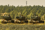 Turkish soldiers stand atop of their tanks at a staging area close to the border with Syria in Sanliurfa province, southeastern Turkey, Thursday, Oct. 17, 2019. U.S. Vice President Mike Pence and State Secretary Mike Pompeo were scheduled to arrive in Ankara and press Turkey's President Recep Tayyip Erdogan to accept a ceasefire in northeast Syria. (AP Photo/Emrah Gurel)