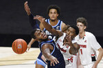 Villanova's Eric Dixon, left, and Hartford's Moses Flowers reach for a loose ball in the first half of an NCAA college basketball game, Tuesday, Dec. 1, 2020, in Uncasville, Conn. (AP Photo/Jessica Hill)