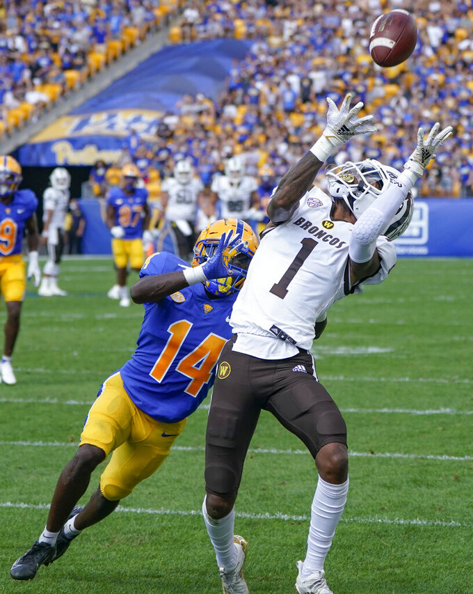 Western Michigan wide receiver Jaylen Hall (1) makes a catch of a long pass as Pittsburgh defensive back Marquis Williams (14) defends during the first half of an NCAA college football game, Saturday, Sept. 18, 2021, in Pittsburgh. (AP Photo/Keith Srakocic)