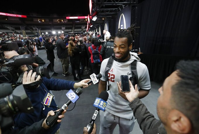 Alabama's Najee Harris answers questions during media day for the NCAA college football playoff championship game Saturday, Jan. 5, 2019, in Santa Clara, Calif. (AP Photo/David J. Phillip)