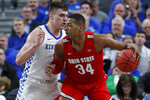 Ohio State's Kaleb Wesson (34) drives into Kentucky's Nate Sestina during the first half of an NCAA college basketball game Saturday, Dec. 21, 2019, in Las Vegas. (AP Photo/John Locher)