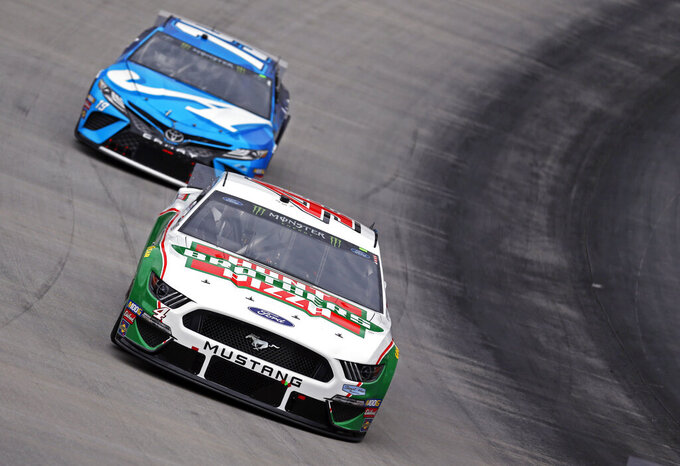 Kevin Harvick (4) leads Martin Truex Jr. (19) during a NASCAR Cup Series auto race, Sunday, April 7, 2019, in Bristol, Tenn. Harvick failed inspection three times before the race. (AP Photo/Wade Payne)(AP Photo/Wade Payne)