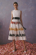 This photo provided by Griffin Marketing and Public Relations and Carolina Herrera shows a model posing for the Carolina Herrera Resort Collection 2020.  The Mexican government accused this week the fashion house Carolina Herrera of cultural appropriation because it incorporated Mexican indigenous elements and embroidery in one of its collections. The fashion house responded Wednesday that it only wanted to pay tribute to the richness of Mexican culture.  ( Carolina Herrera via AP)