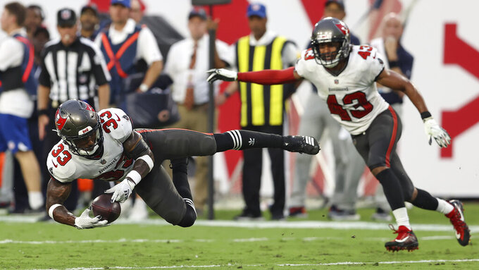 Tampa Bay Buccaneers free safety Jordan Whitehead (33) intercepts a pass by Chicago Bears quarterback Justin Fields during the second half of an NFL football game Sunday, Oct. 24, 2021, in Tampa, Fla. (AP Photo/Mark LoMoglio)