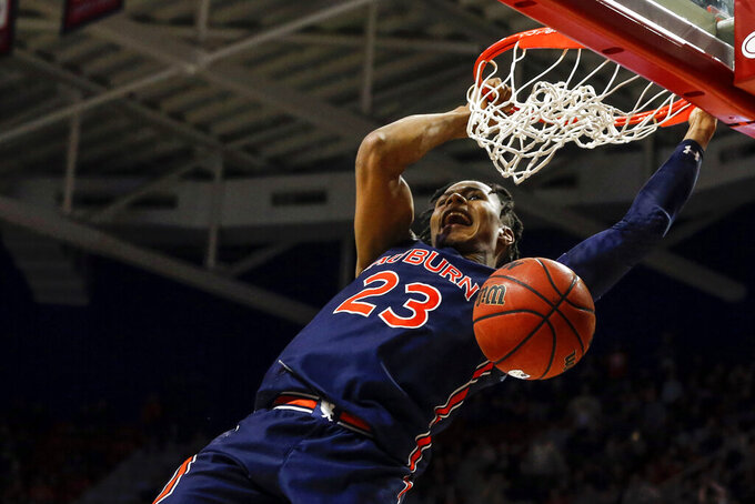 Auburn forward Isaac Okoro (23) slam dunks the ball during the second half of an NCAA college basketball game against South Alabama, Tuesday, Nov. 12, 2019, in Mobile, Ala. Auburn won 70-69. (AP Photo/Butch Dill)