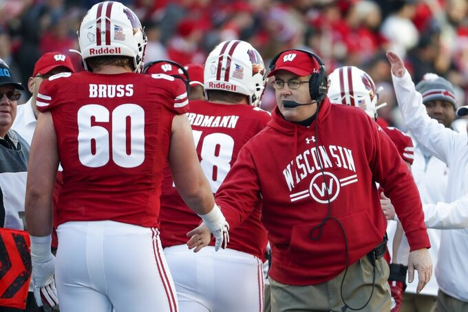 Wisconsin head coach Paul Chryst congratulates Logan Bruss after a touchdown during the first half of an NCAA college football game against Purdue Saturday, Nov. 23, 2019, in Madison, Wis. (AP Photo/Morry Gash)