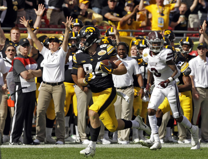 Iowa wide receiver Nick Easley (84) beats Mississippi State cornerback Cameron Dantzler (3) on a 75-yard touchdown reception during the first half of the Outback Bowl NCAA college football game, Tuesday, Jan. 1, 2019, in Tampa, Fla. (AP Photo/Chris O'Meara)