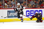 Carolina Hurricanes' Jordan Martinook (48) falls while chasing Arizona Coyotes' Phil Kessel (81) during the second period of an NHL hockey game in Raleigh, N.C., Friday, Jan. 10, 2020. (AP Photo/Karl B DeBlaker)