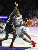 Arizona guard Justin Coleman (12) drives on Washington State guard Ahmed Ali during the second half during an NCAA college basketball game Saturday, Feb. 9, 2019, in Tucson, Ariz. Washington State defeated Arizona 69-55. (AP Photo/Rick Scuteri)