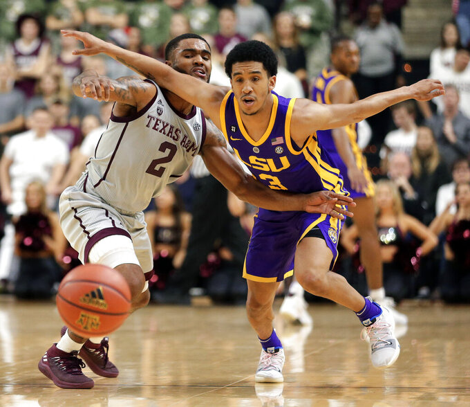 Texas A&M guard TJ Starks (2) and LSU guard Tremont Waters (3) chase the ball during the second half of an NCAA college basketball game Wednesday, Jan. 30, 2019, in College Station, Texas. (AP Photo/Michael Wyke)