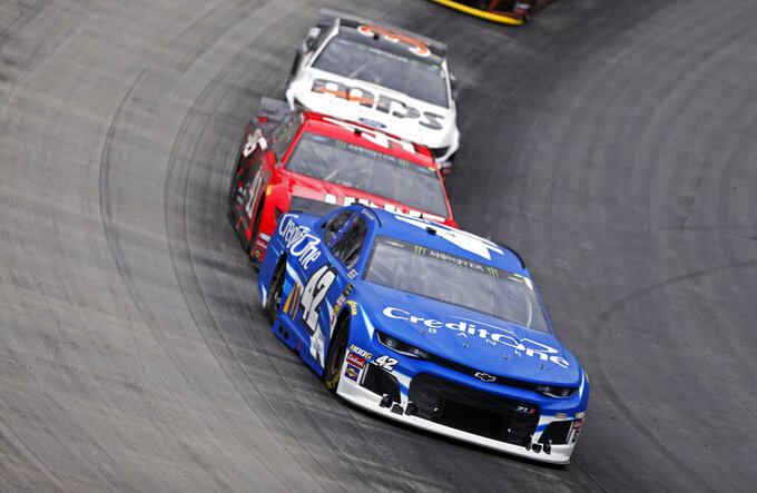 Corey LaJoie (32) leads Daniel Suarez (41) and David Ragan (38) through a turn during a NASCAR Cup Series auto race, Sunday, April 7, 2019, in Bristol, Tenn. (AP Photo/Wade Payne)