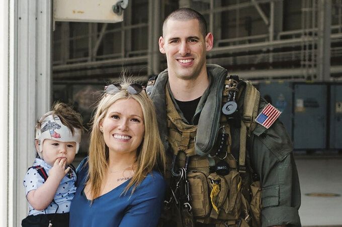 This undated photo released by the U.S. Navy shows Naval Air Crewman (Helicopter) 2nd Class James P. Buriak, 31, from Salem, Va., his wife Megan, and their son Caulder. Buriak was one of five sailors who died when an MH-60S helicopter crashed in the Pacific Ocean on Aug. 31, 2021, about 70 miles (112 kilometers) off San Diego during what the Navy described as routine flight operations. It was operating from the deck of the aircraft carrier USS Abraham Lincoln. (Petty Officer 1st Class David Mora/U.S. Navy via AP)