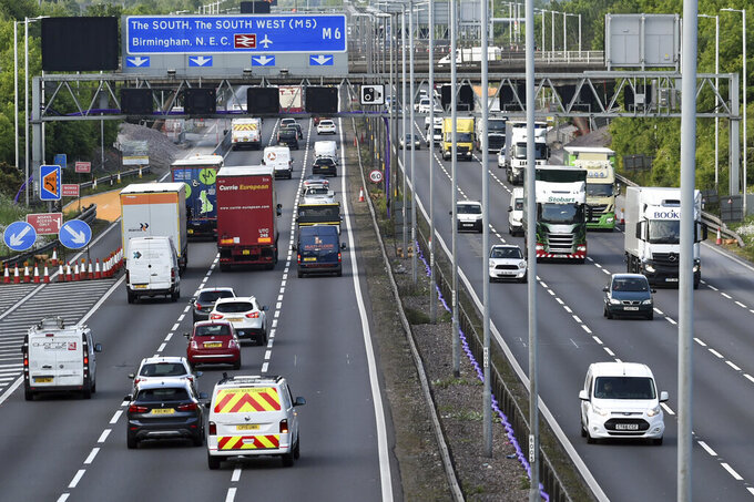 """FILE - In this May 18, 2020, file photo, traffic moves along the M6 motorway near Birmingham, England. Britain will ban the sale of new gasoline and diesel cars by 2030, a decade earlier than its previous commitment, the prime minister said Tuesday, Nov. 17, 2020. Boris Johnson made the pledge as part of plans for a """"green industrial revolution"""" that he claims could create up to 250,000 jobs in energy, transport and technology. (AP Photo/Rui Vieira, File)"""