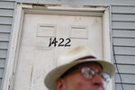 """Gary Zaremba stands outside one of his rental properties, Thursday, Aug. 12, 2021, in the Queens borough of New York. Landlords say they have suffered financially due to various state, local and federal moratoriums in place since last year. """"Without rent, we're out of business,"""" said Zaremba. (AP Photo/John Minchillo)"""