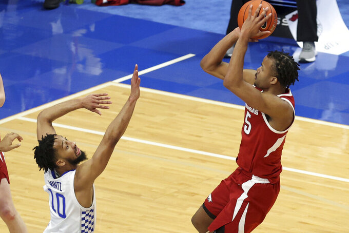 Arkansas' Moses Moody, right, shoots while guarded by Kentucky's Davion Mintz during the second half of an NCAA college basketball game in Lexington, Ky., Tuesday, Feb. 9, 2021. (AP Photo/James Crisp)