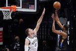 Milwaukee Bucks center Brook Lopez (11) defends as Brooklyn Nets forward Kevin Durant (7) shoots during the first half of Game 5 of a second-round NBA basketball playoff series Tuesday, June 15, 2021, in New York. (AP Photo/Kathy Willens)