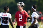 Atlanta Falcons quarterback Matt Ryan (2) talks to receivers Calvin Ridley (18) and Russell Gage (14) during the team's NFL training camp football practice in Flowery Branch, Ga. Thursday, July 29, 2021. (AP Photo/ John Bazemore)
