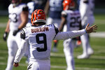 Cincinnati Bengals quarterback Joe Burrow (9) motions a first down during the first half of an NFL football game against the Tennessee Titans, Sunday, Nov. 1, 2020, in Cincinnati. (AP Photo/Bryan Woolston)