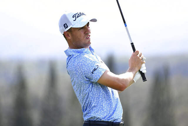 Justin Thomas watches a shot during the second round of the Tournament of Champions golf event Friday, Jan. 8, 2021, at Kapalua Plantation Course in Kapalua, Hawaii. (Matthew Thayer/The Maui News via AP)