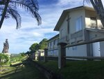 FILE - This Nov. 7, 2018, file photo, shows the residence and office of the Archbishop of Agana in Guam. No doctors are willing to perform abortions in the U.S. territory of Guam, and the island's first female governor is concerned about the fallout. Gov. Lourdes Leon Guerrero fears women will seek illegal or dangerous alternatives after the last abortion provider retired last year. Abortion is legal in the heavily Catholic Pacific island, but doctors can deny services unless it's a medical emergency. (AP Photo/Grace Garces Bordallo, File)