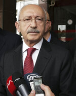Kemal Kilicdaroglu, the leader of Turkey's main opposition Republican People's Party, speaks to the media after visiting Yavuz Selim Demirag, a Turkish journalist critical of President Recep Tayyip Erdogan's government and its nationalist allies, outside a hospital in Ankara, Turkey, Saturday, May 11, 2019. Yenicag newspaper says Saturday columnist Demirag was beaten by a group of about five or six people with baseball bats outside his home after appearing on a TV show late Friday.(AP Photo/Burhan Ozbilici)