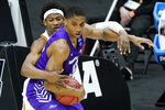 Texas' Kai Jones, left, defends against Abilene Christian's Joe Pleasant (32) during the first half of a college basketball game in the first round of the NCAA tournament at Lucas Oil Stadium in Indianapolis Saturday, March 20, 2021. (AP Photo/Mark Humphrey)