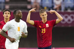 Spain's Dani Olmo (19) celebrates scoring his side's opening goal against Ivory Coast in a men's quarterfinal soccer match at the 2020 Summer Olympics, Saturday, July 31, 2021, in Rifu, Japan, Tokyo. (AP Photo/Andre Penner)