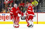 Detroit Red Wings goaltender Jonathan Bernier (45) replaces goaltender Jimmy Howard (35) in the second period of an NHL hockey game against the Nashville Predators, Monday, Nov. 4, 2019, in Detroit. (AP Photo/Paul Sancya)