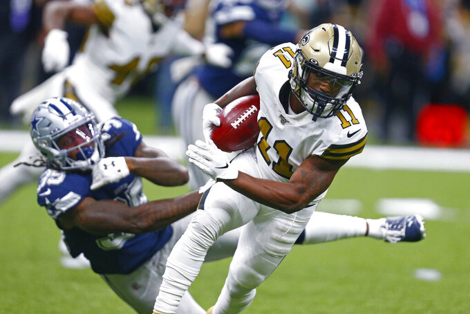 New Orleans Saints wide receiver Deonte Harris (11) eludes Dallas Cowboys free safety Kavon Frazier (35) on a kickoff return in the first half of an NFL football game in New Orleans, Sunday, Sept. 29, 2019. (AP Photo/Butch Dill)