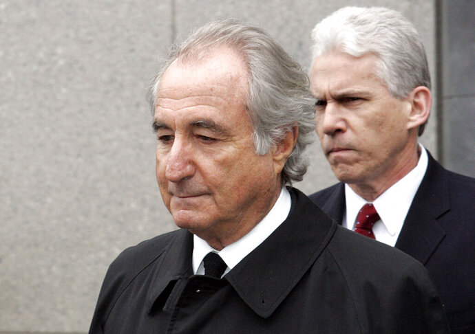 FILE - In this March 10, 2009, file photo, former financier Bernie Madoff exits federal court in Manhattan, in New York. The Supreme Court is leaving in place a lower court ruling that allows the trustee recovering money for investors in the Bernard Madoff Ponzi scheme to pursue more than $4 billion that went to overseas investors. The high court on Monday, June 1, 2020, declined to take the case. (AP Photo/David Karp, File)