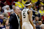 Michigan State coach Tom Izzo speaks to Cassius Winston (5) during the first half of a second round men's college basketball game against Minnesota in the NCAA Tournament, in Des Moines, Iowa, Saturday, March 23, 2019. (AP Photo/Nati Harnik)