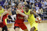 Seattle Storm's Natasha Howard, right, tries to get past Las Vegas Aces' Dearica Hamby late in the second half of a WNBA basketball game Friday, July 19, 2019, in Seattle. The Storm won 69-66. (AP Photo/Elaine Thompson)