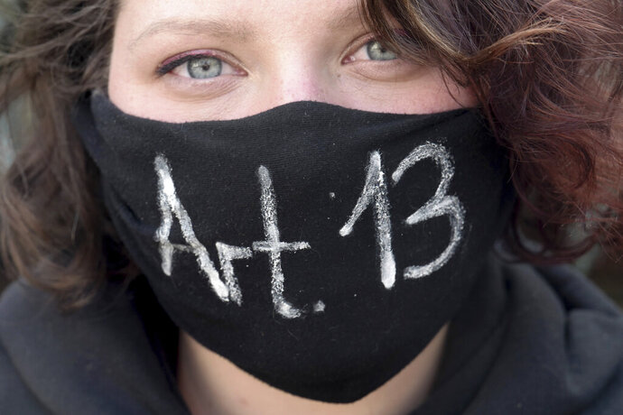 A girl protests against article 13, concerning upload filters, of the Directive on Copyright in the Digital Single Market by the European Union in Leipzig, Germany, Saturday, March 23, 2019. People fear for the freedom of the internet when users content has to pass upload filters to protect copyrights. (Peter Endig/dpa via AP)