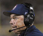 FILE - In this Saturday, Sept. 5, 2009, file photo, Samford head coach Pat Sullivan looks up at the scoreboard late in the second half of an NCAA college football game against Central Florida in Orlando, Fla. Sullivan, the 1971 Heisman Trophy winner at Auburn who went on to coach TCU and Samford, died Sunday, Dec. 1, 2019. He was 69. (AP Photo/Phelan M. Ebenhack, File)