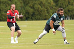 Philadelphia Eagles quarterback Carson Wentz, left, takes a snap from center Jason Kelce, right, during an NFL football practice, Thursday, Sept. 24, 2020, in Philadelphia. (AP Photo/Chris Szagola, Pool)
