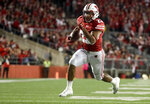 FILE - In this Saturday, Oct. 6, 2018, file photo, Wisconsin's Jonathan Taylor runs for a touchdown during the second half of an NCAA college football game against Nebraska in Madison, Wis. Taylor was selected a preseason All-American by AP poll voters after running for more than 2,00 yards last season. (AP Photo/Morry Gash, File)