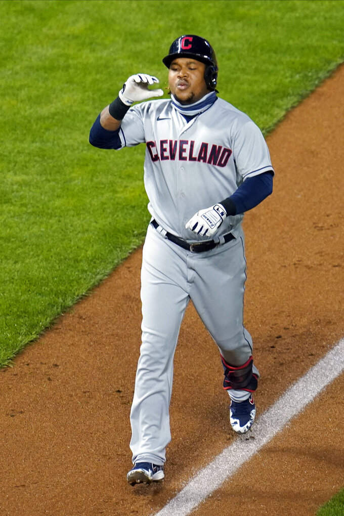 Cleveland Indians' Jose Ramirez jogs toward home on a solo home run off Minnesota Twins pitcher Rich Hill in the fourth inning of a baseball game Saturday, Sept. 12, 2020, in Minneapolis. (AP Photo/Jim Mone)