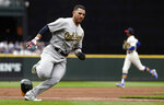 Oakland Athletics' Ramon Laureano races home to score against the Seattle Mariners in the first inning of a baseball game Sunday, July 7, 2019, in Seattle. (AP Photo/Elaine Thompson)