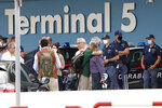 A group including Italian diplomats, civilians and Afghan collaborators leave Rome's Fiumicino international airport, after disembarking from an Italian Air force plane that evacuated them from Kabul, Afghanistan, Monday, Aug. 16, 2021. (AP Photo/Riccardo De Luca)