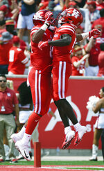 Houston tight end Romello Brooker, left, celebrates his touchdown with Marquez Stevenson during the first half of an NCAA college football game against Arizona, Saturday, Sept. 8, 2018, in Houston. (AP Photo/Eric Christian Smith)