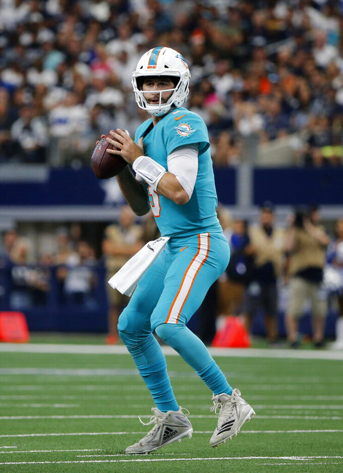 Miami Dolphins quarterback Josh Rosen (3) throws a pass in the first half of an NFL football game against the Dallas Cowboys in Arlington, Texas, Sunday, Sept. 22, 2019. (AP Photo/Michael Ainsworth)
