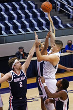 BYU center Richard Harward, right, shoots as Gonzaga forward Drew Timme (2) defends in the first half during an NCAA college basketball game Monday, Feb. 8, 2021, in Provo, Utah. (AP Photo/Rick Bowmer)